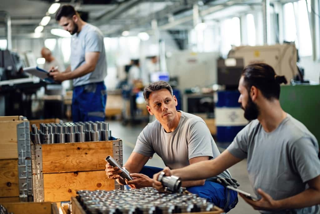 Essential Pros Staffing Franchise employees at work in factory