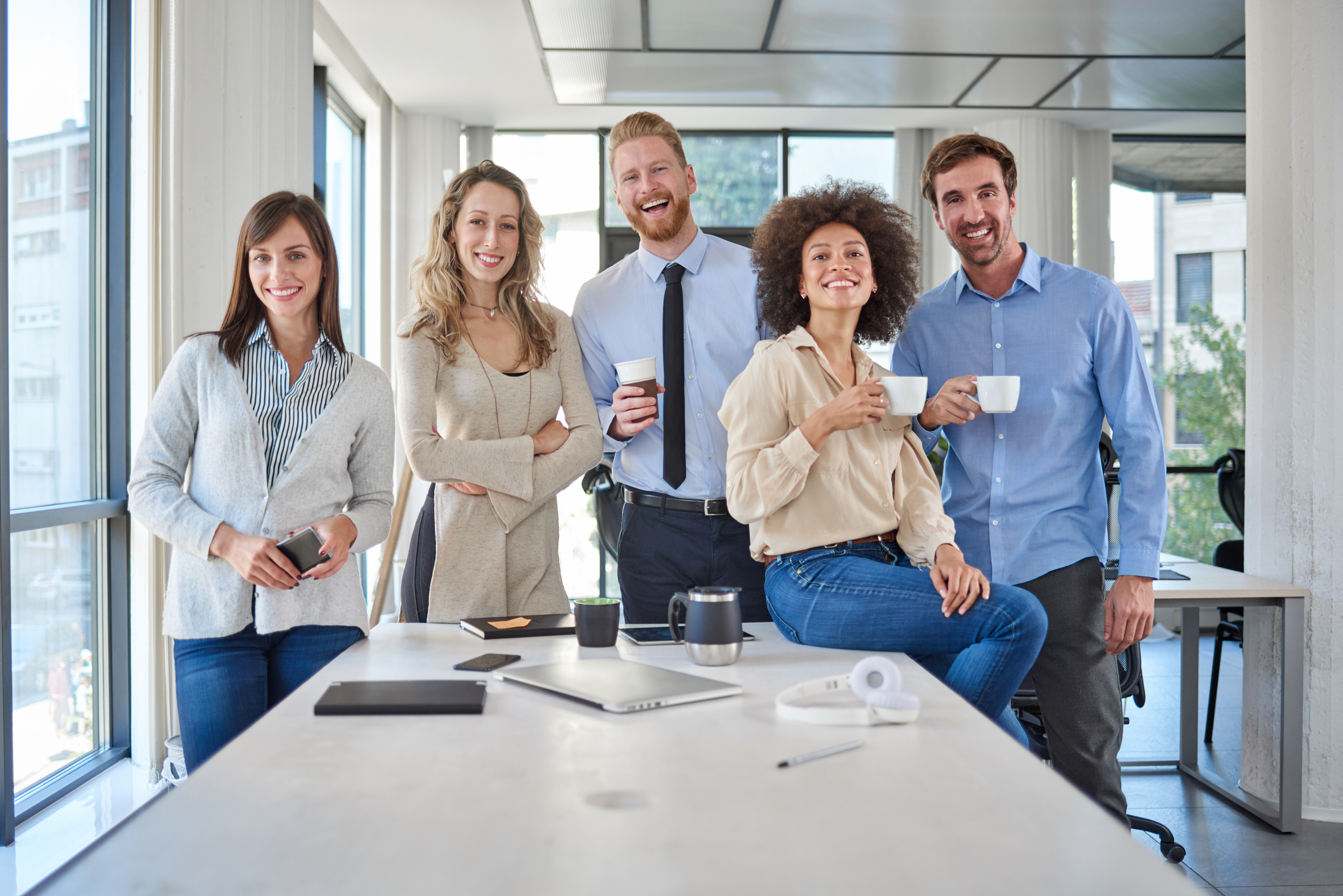personnel franchise - employees gathered in office cheerful